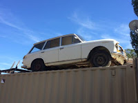 Quickie: Datsun 411 Wagon Roller on Top of a Shipping Container